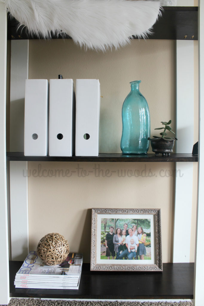 Modern diy shelves with white planks contrasting espresso stained shelves.
