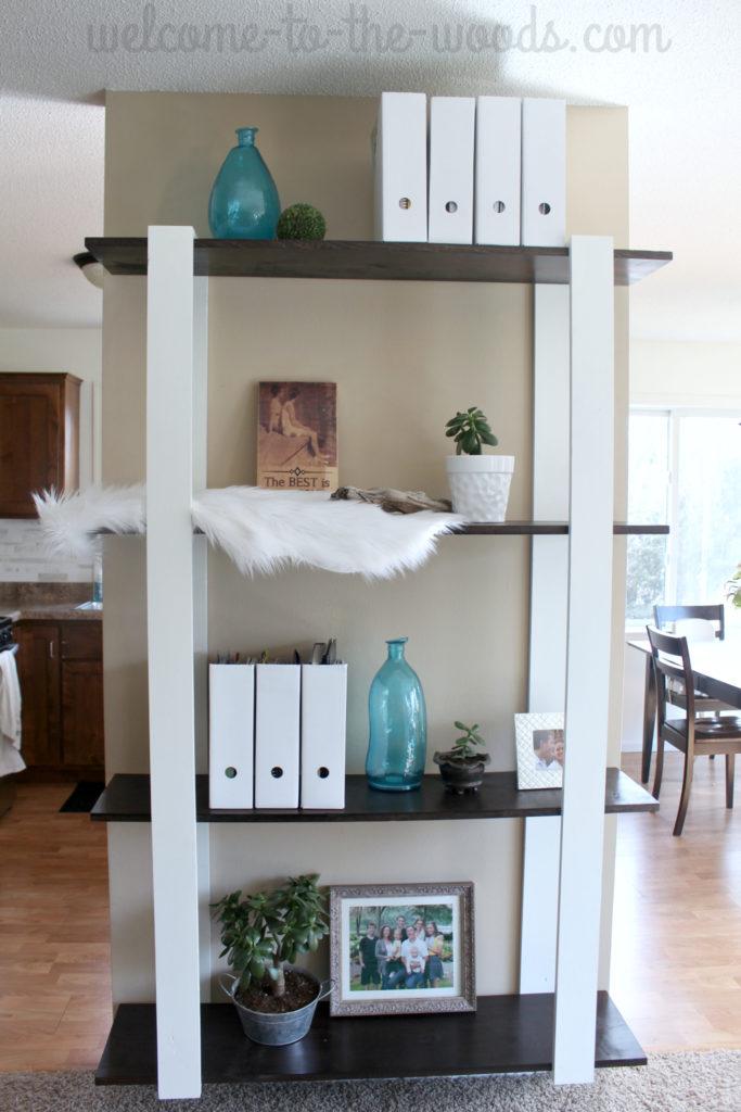 Custom built wood shelves for only $25 in lumber! Amazing modern design. I love it!