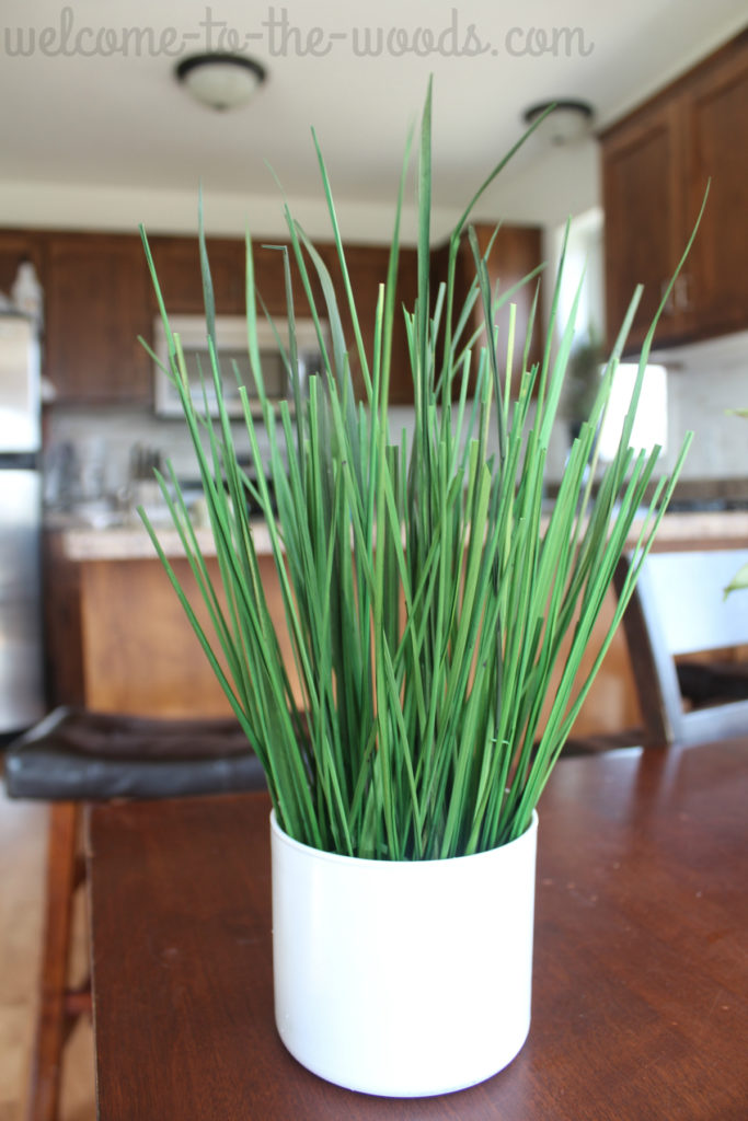 Faux potted grass plant, knockoff from IKEA. This easy summer craft is perfect to do with your kids.