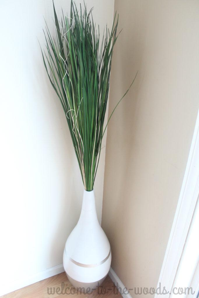 Vase full of green grass reeds for summer