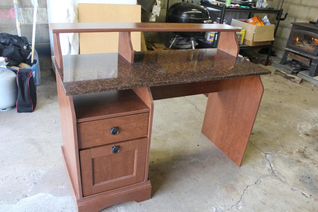Old desk revamped into a pallet wood reception desk.