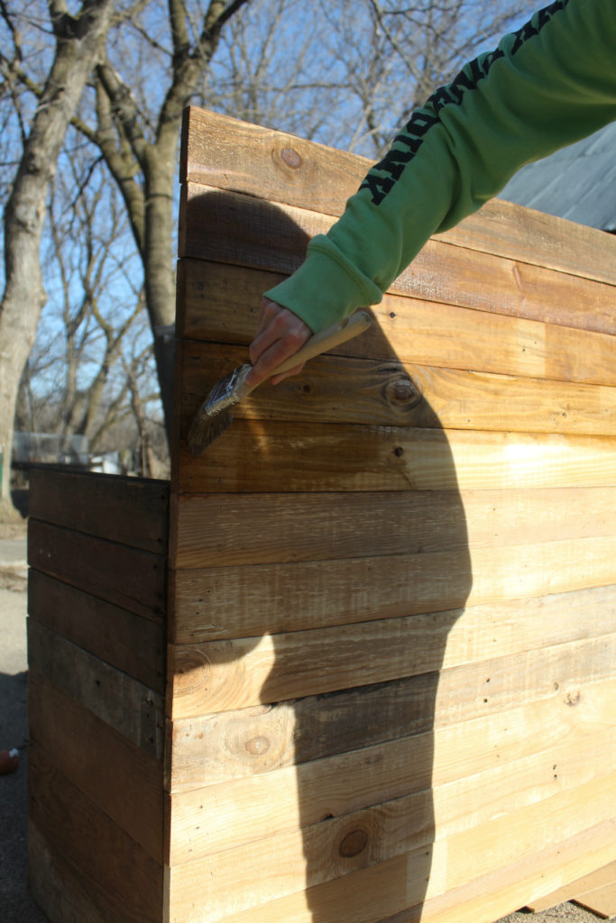 Staining reclaimed barn wood.