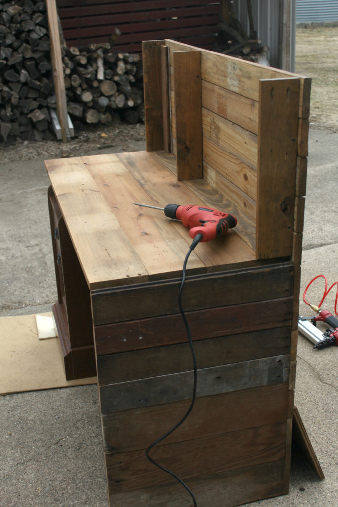 Cover existing piece of furniture with reclaimed barn wood for an industrial chic look.