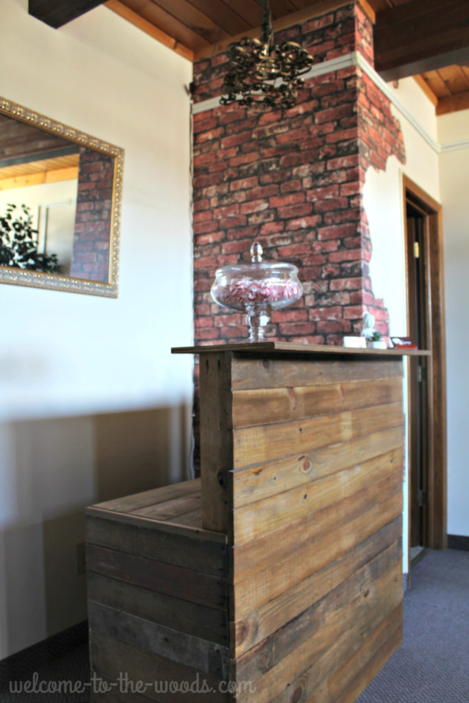 Cover existing piece of furniture with reclaimed barn wood for an industrial chic look