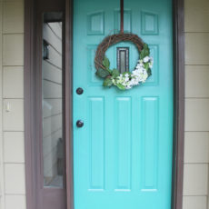 Turquoise front door color, paint your entryway door a bright cheerful color!