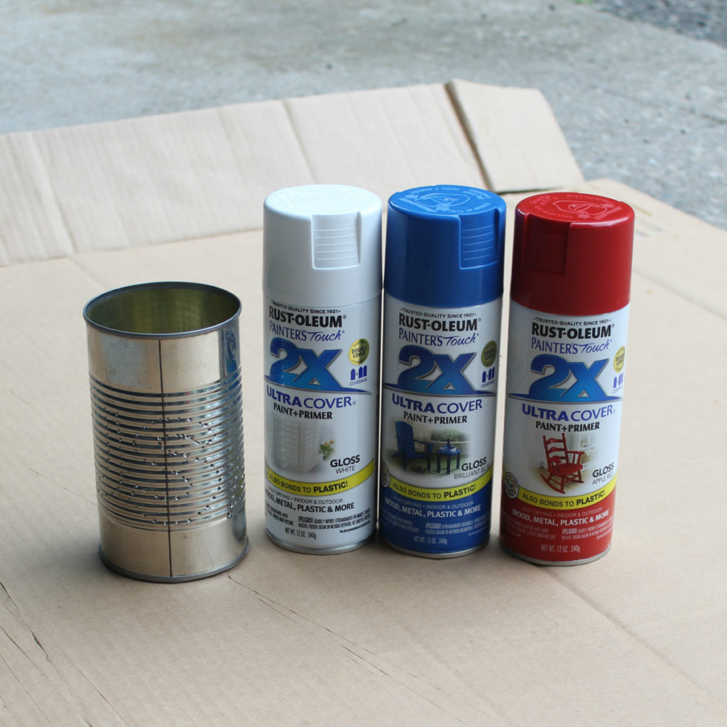Spray paint Rustoleum on old tin cans
