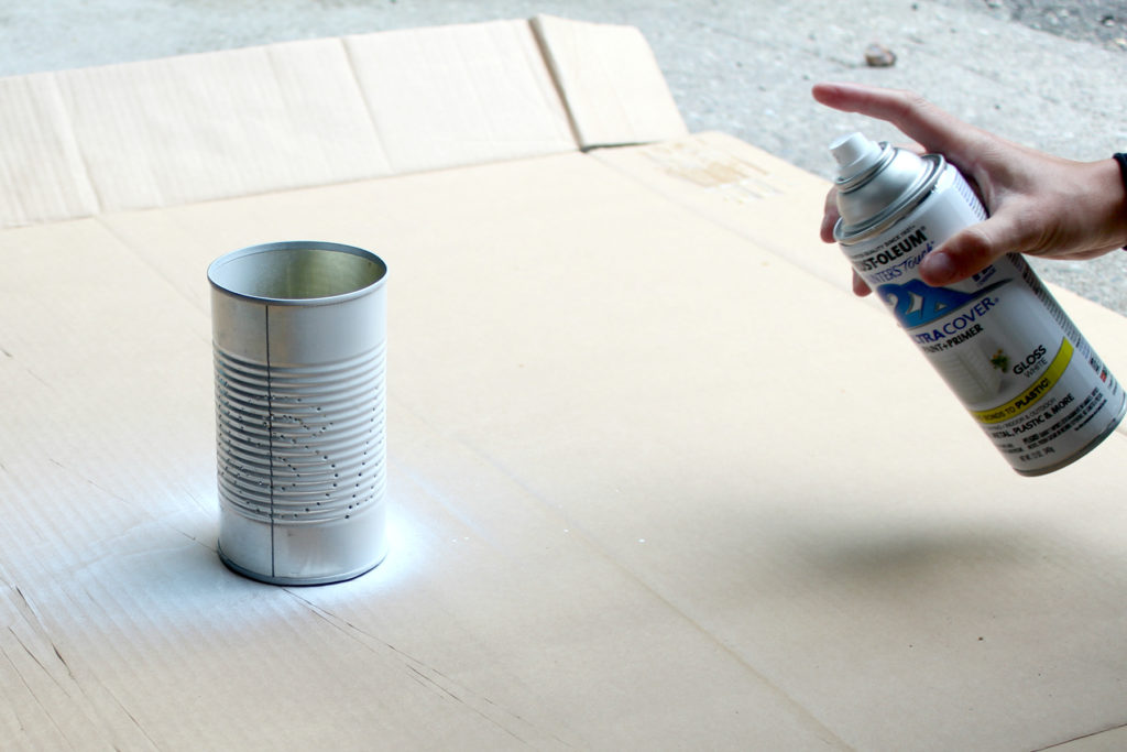 Spray painting tin cans to use for crafts - so easy!