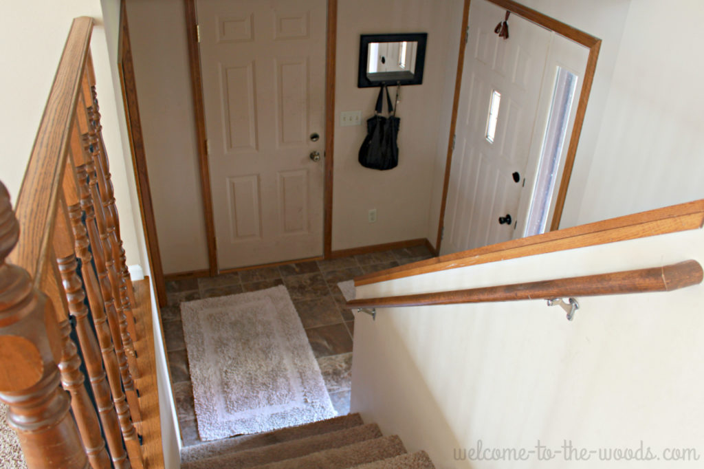 Outdated oak entryway get a major change in this entryway makeover