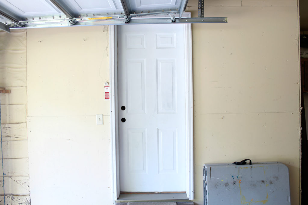 Ugly garage door entrance ready for a redo to make the space more functional and pleasing.