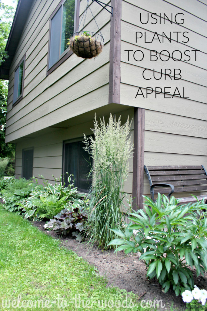 Various perennial plants fill the flower beds surrounding this house, low maintenance landscaping to boost your curb appeal