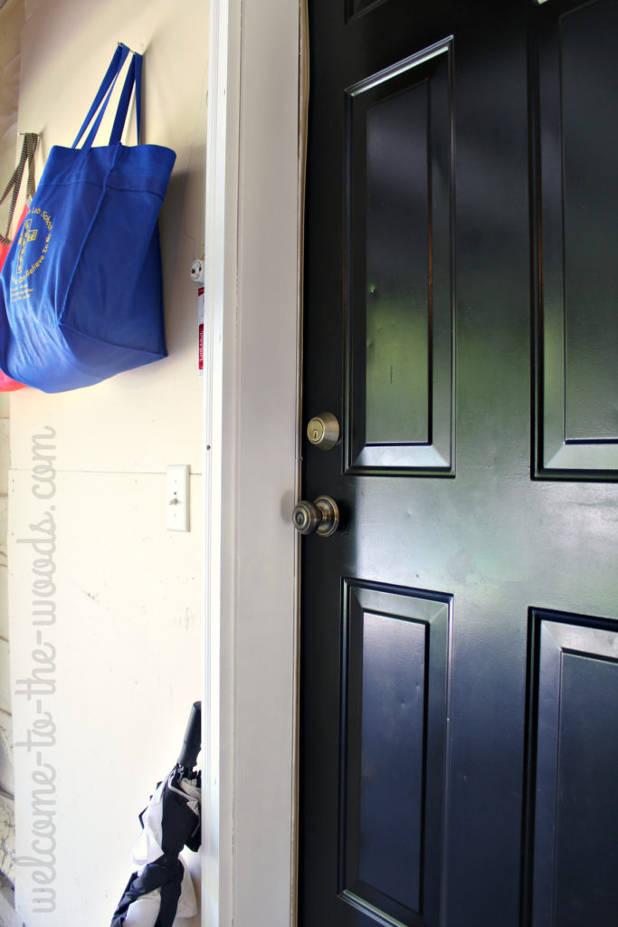 Paint the door to your home from inside your garage black for interest and low-maintenance cleaning.