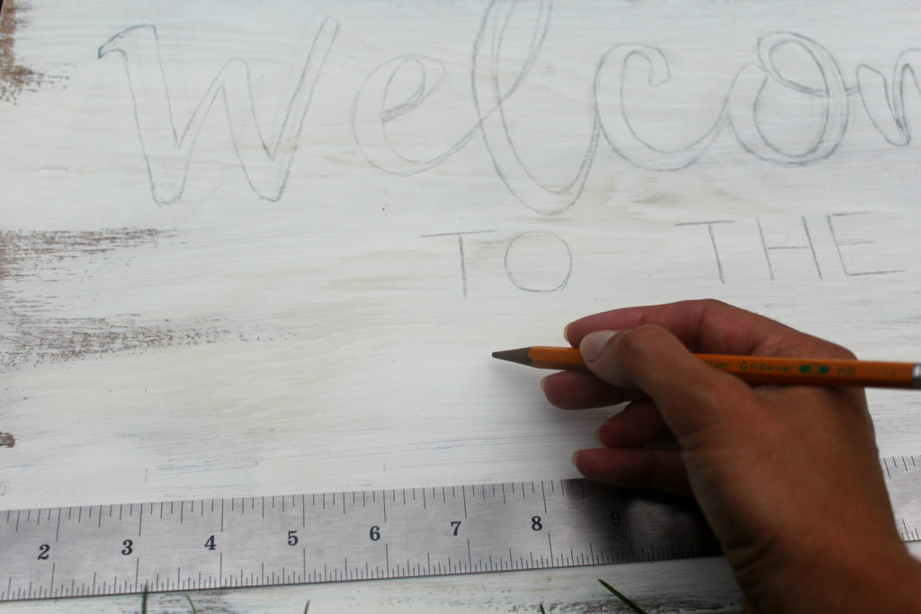 Before writing out your wood sign, measure and mark. Use a pencil to outline where everything goes.