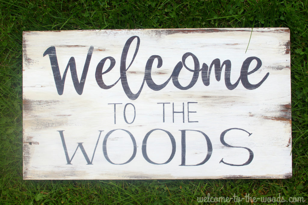 Distressed wood sign diy tutorial, freehand lettering by Melissa of Welcome to the Woods