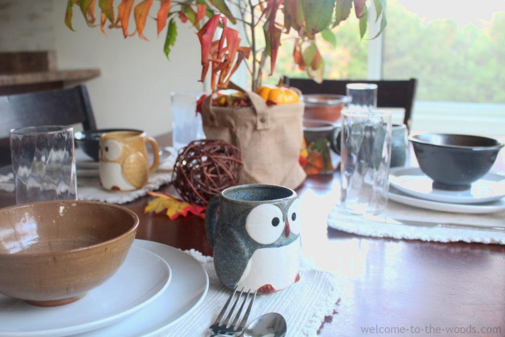 Beautiful autumn tablescape idea with sumac centerpiece and adorable ceramic owl mugs