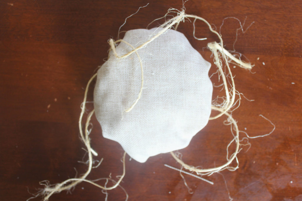 Make a fabric pumpkin with old cloth and twine