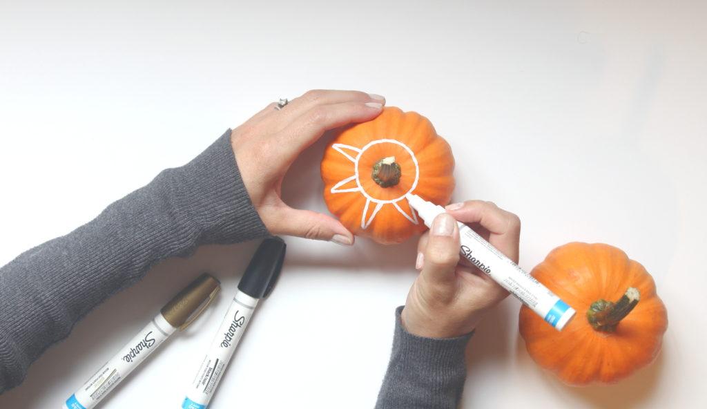 Pumpkin decor using sharpies to draw on pumpkins is cute idea!