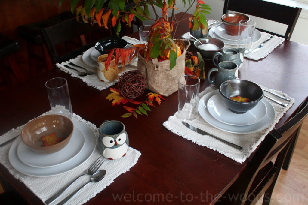 Beautiful rustic fall tablescape with handmade ceramics, leaves, real sumac branches in the centerpiece, and more!