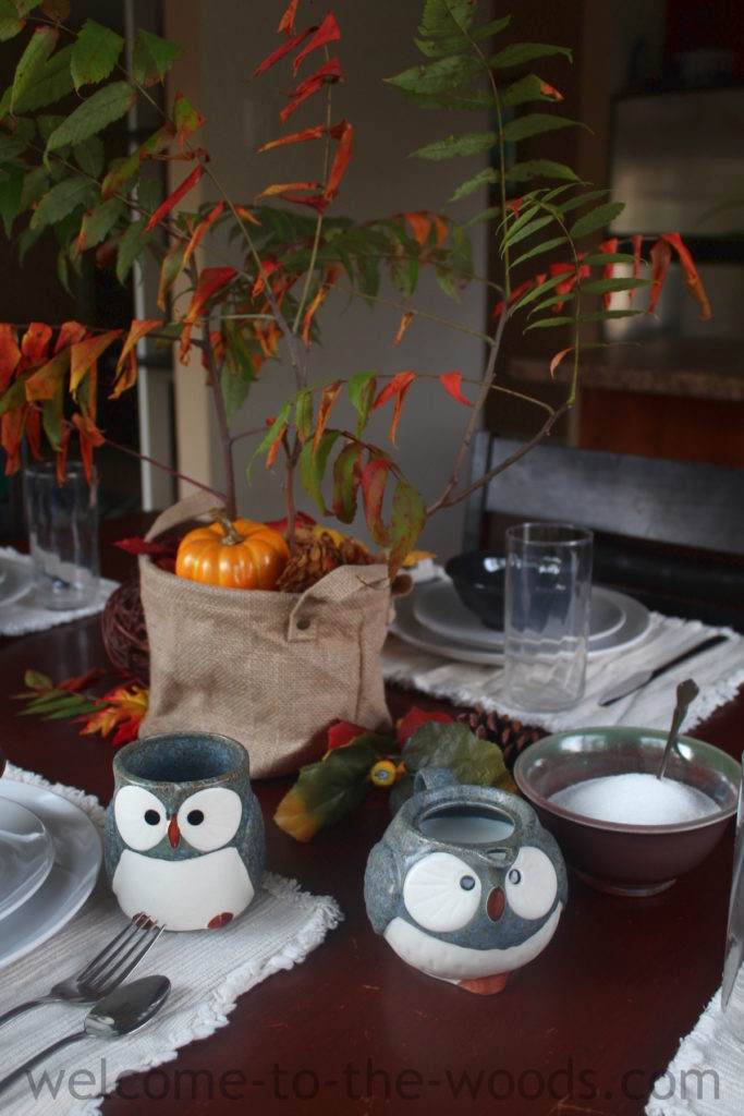 A gorgeous fall tablescape that is cozy and cute! I LOVE those owl mugs and the little creamer pitcher!