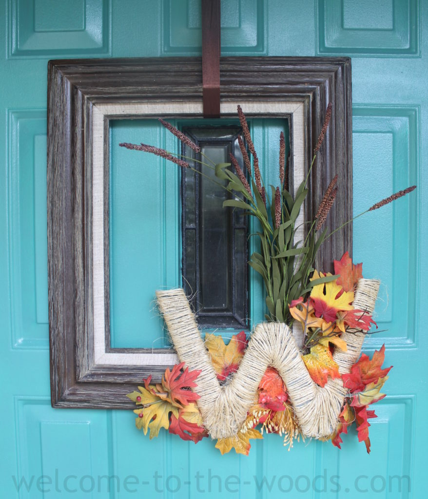 Instead of a traditional autumn wreath on your front door, try a picture frame wreath! Love the monogram W too!