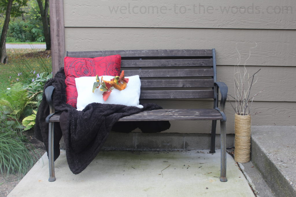 If you don't have a front porch, adding a bench near the front steps is the next best thing! This autumn arrangement looks so welcoming and cozy!