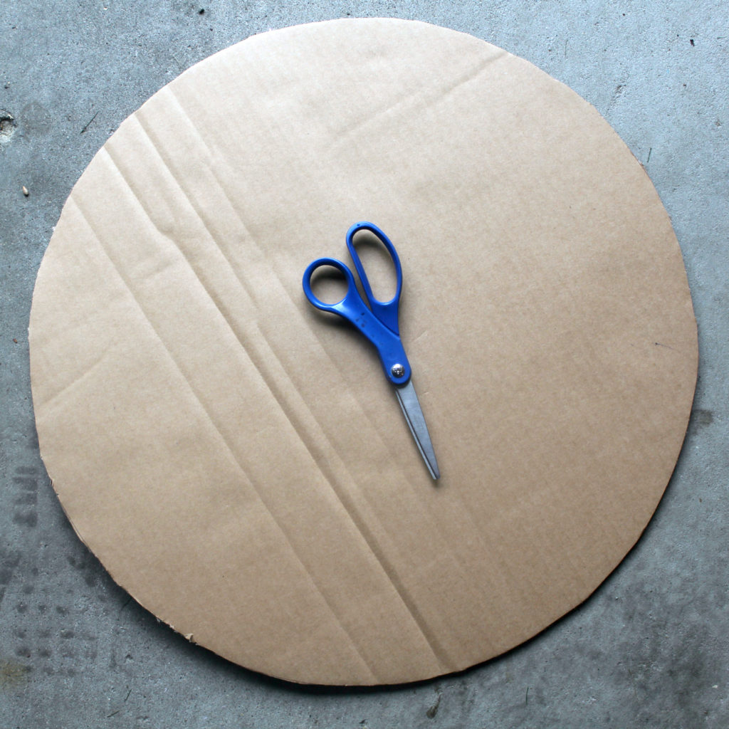Step 1: cut out a large circle of cardboard