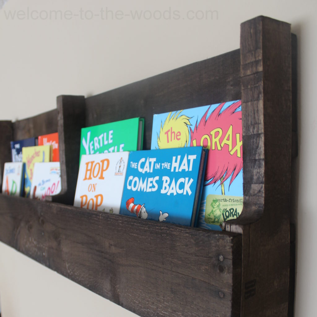 Store books in an adorable fashion - perfect for a baby nursery - made using just a pallet!