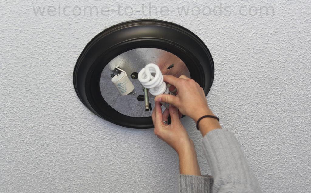 Screwing in a light bulb, fixing a light fixture, diy drum chandelier tutorial