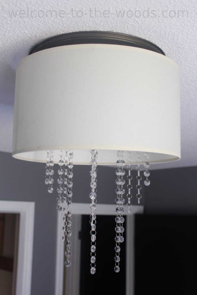 DIY drum chandelier photo tutorial. She made this for a total of $6!