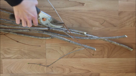 Using sticks to create an adorable Merry Mail Tree for displaying Christmas cards