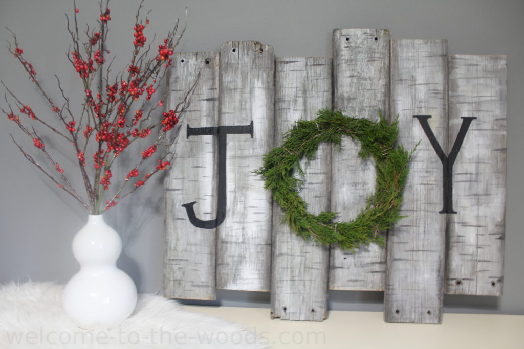 Watch the video tutorial to show you exactly how to make this birch wood sign for holiday decor!