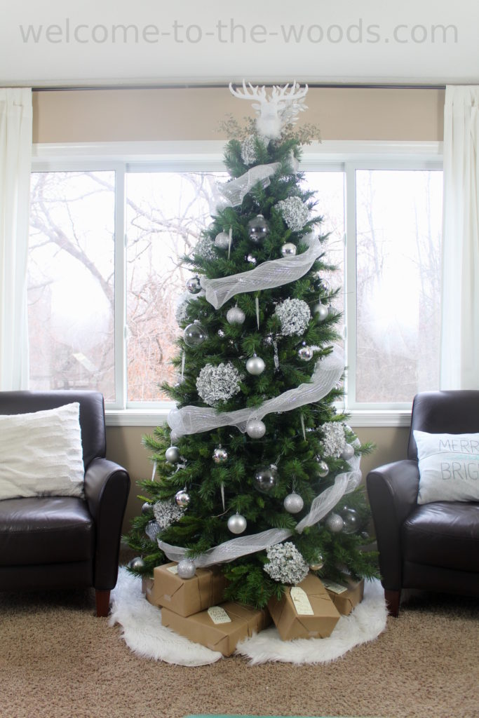 White Woodland Winter Christmas tree. Burlap ribbon, silver ornaments, painted hydrangea blooms, icicles, glittery branches and more!