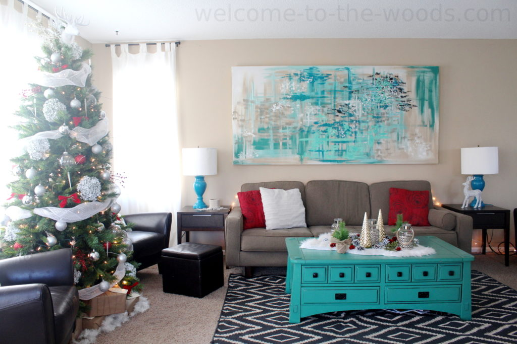 Living room Christmas decor that goes with teal turquoise furniture. Decorating for the holidays red and white and teal