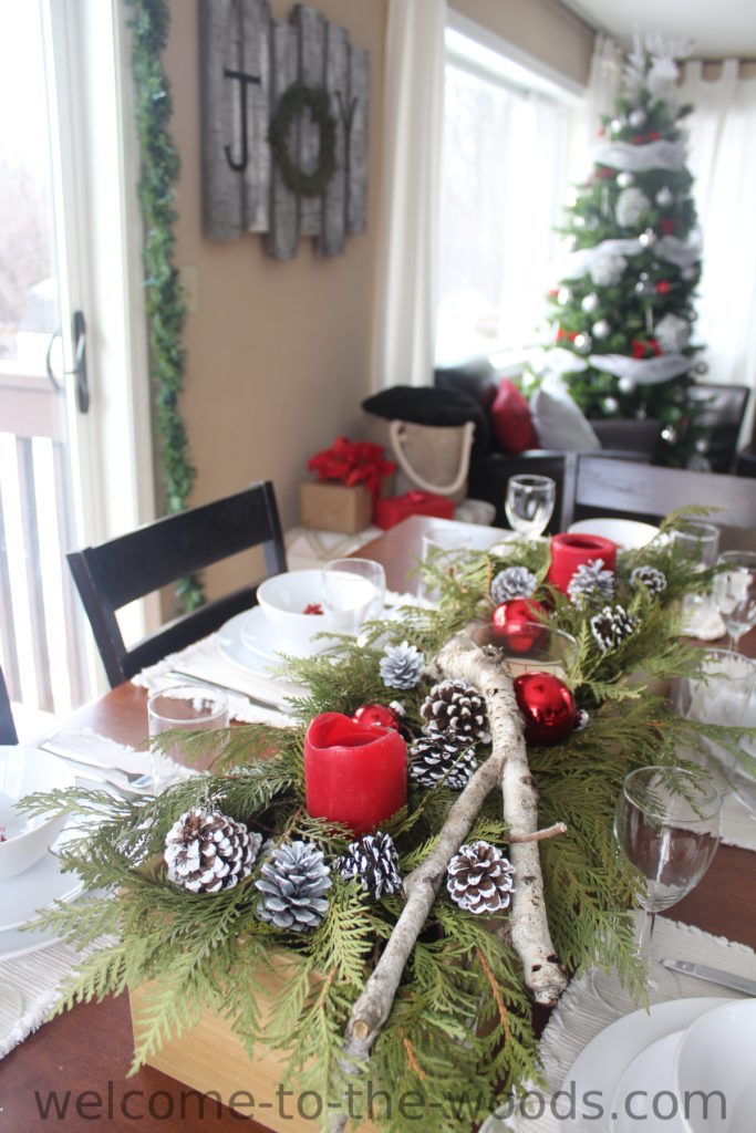 Adorable tablescape white winter woodland theme with simple place settings and a gorgeous DIY candle centerpiece!