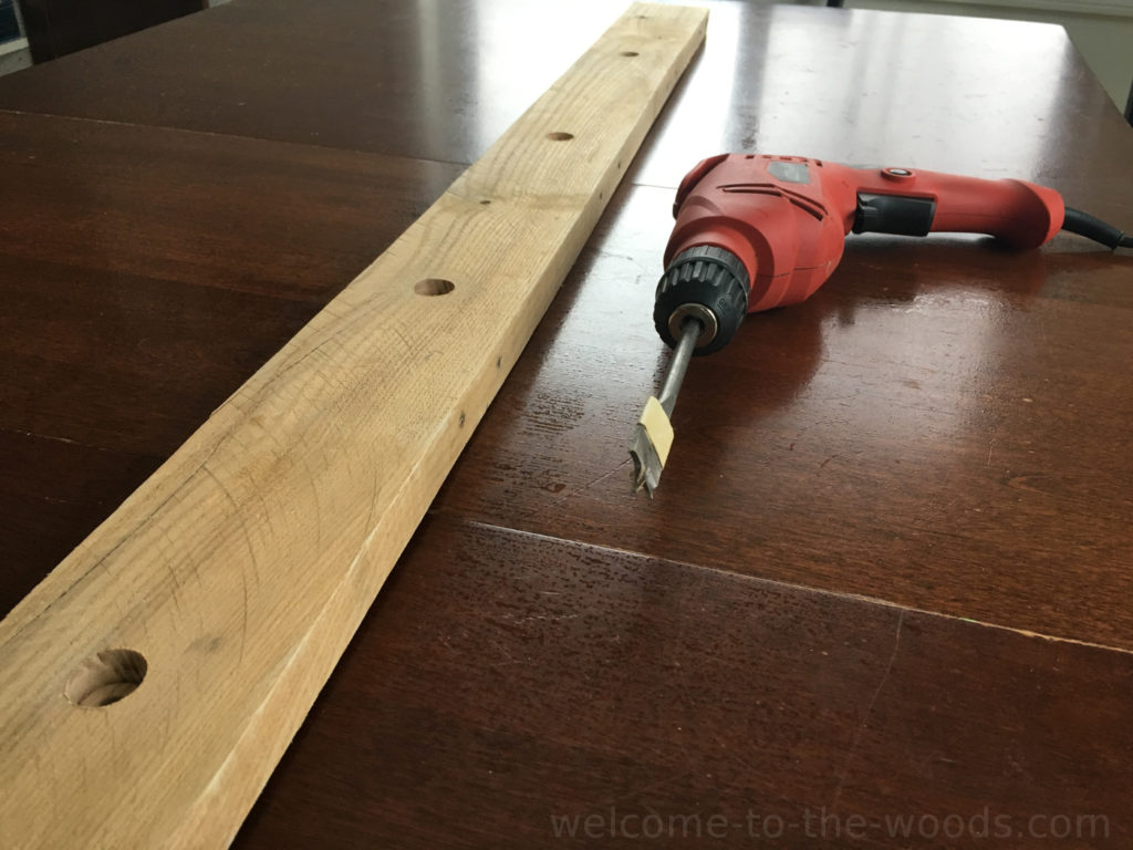 """Use a 3/4"""" spade bit to drill holes for a 1/2"""" steel conduit pole to rest in."""