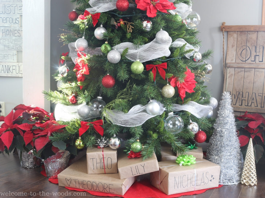Display other decoration items at the base of your tree alongside presents for a more finished